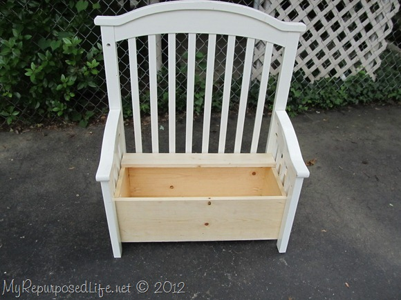 I used screws through each of the side slats and the back of the bottom brace to attach the box to the new bench.