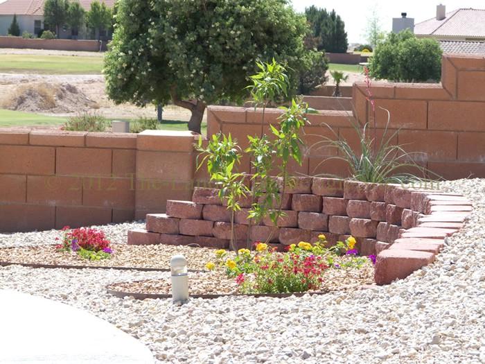 Desert southwest landscaping on a small hillside circular for Southwest landscaping plants