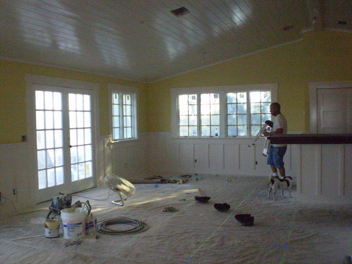 New tongue and groove ceiling, windows and French doors, wainscoting.