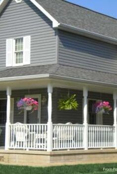 hanging baskets add wow to your porch, flowers, gardening, Flowers and ferns hung between the columns of this wrap around porch create a sweet farmhouse look