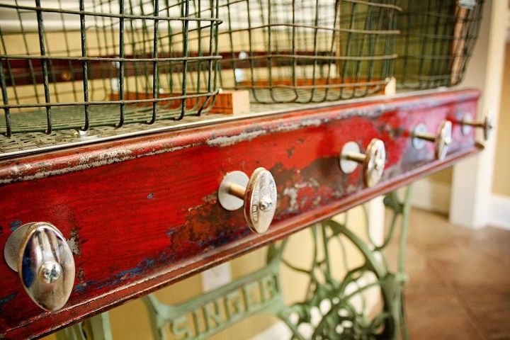 Old faucet/valve handles serve as posts to hang aprons, clothes, bags, etc.  Repurposed Red Wagon Sewing Machine Base Storage Table by GadgetSponge