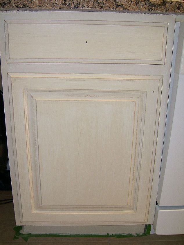 I used two coats of Annie Sloan's chalk paint, white washed ( paint thinned with water) with an off white paint, distressed and clear coated with a poly top coat.