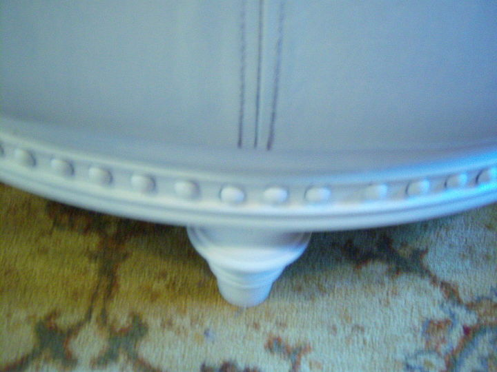 Close up of the leg and wood trim