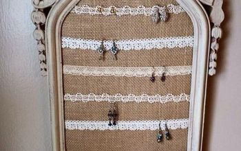 Old ornate frame gets a new life as a elegant earring display.