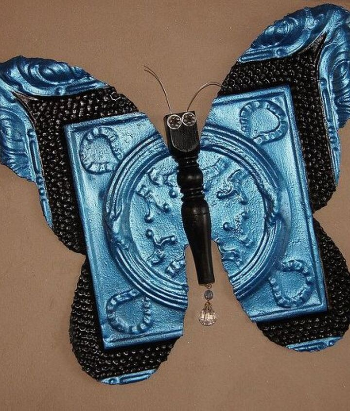 Painted with metallic blue and black craft paint. Sealed with Krylon Clear Satin.