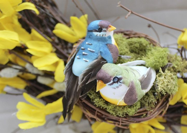In the bottom left corner, a small nest filled with moss and a couple of feather birds was added as a focal point.