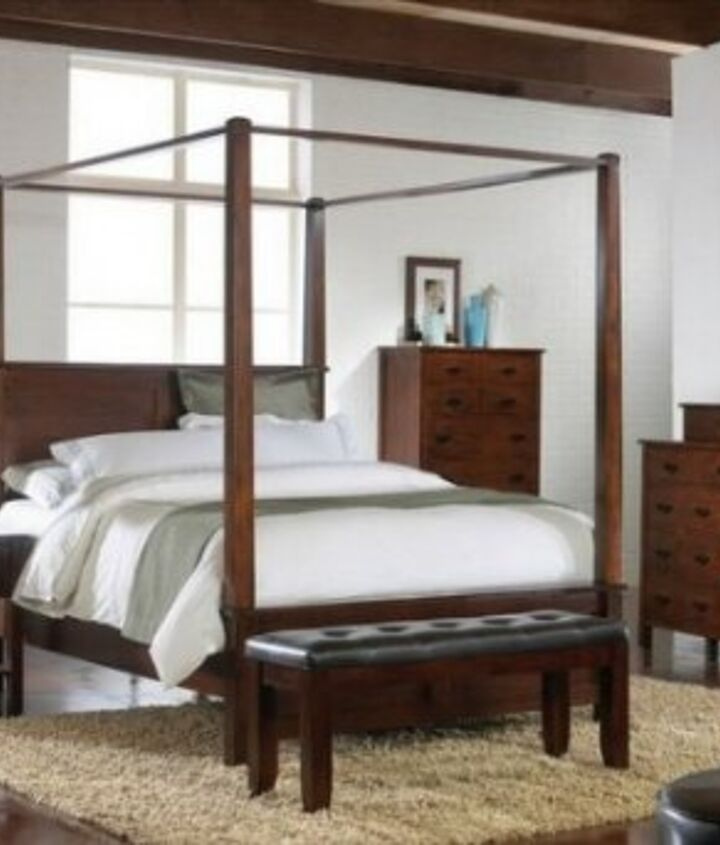 Add fabric to your four poster bed.. use a hook in the ceiling to raise your fabric and stop it from falling into the center of the bed