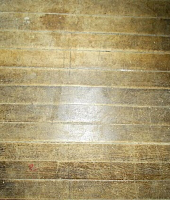 The old, wavy, dirty floor