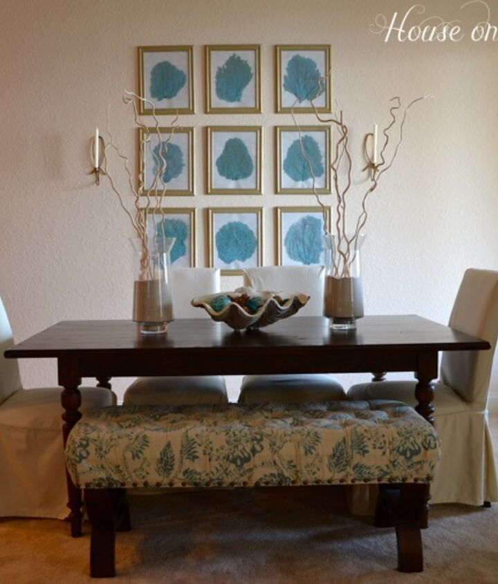 The aqua color of the sea fans coordinates with the bench that sits at the table.