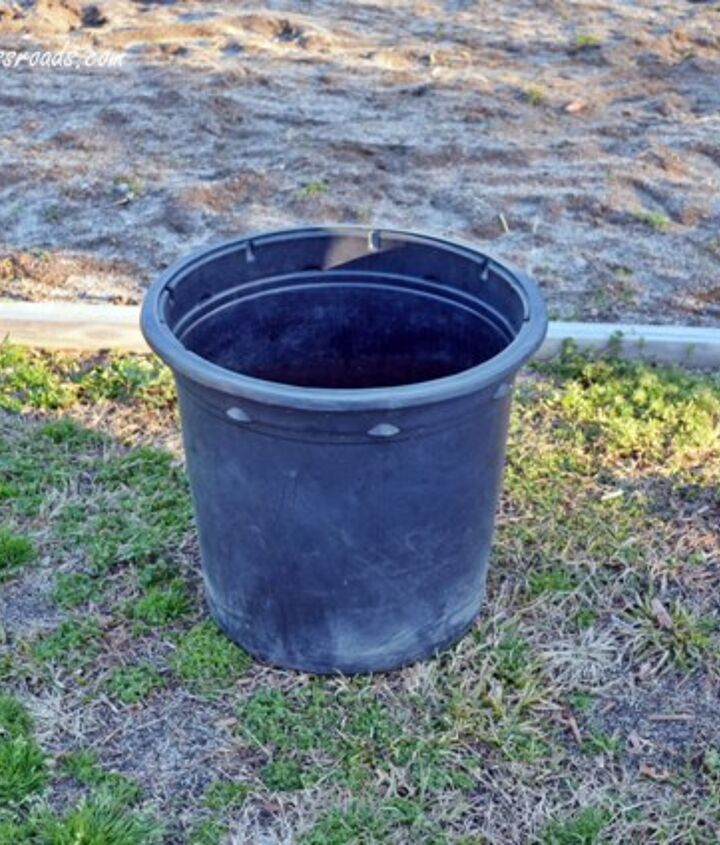 black, plastic 5 gallon container that a tree came in