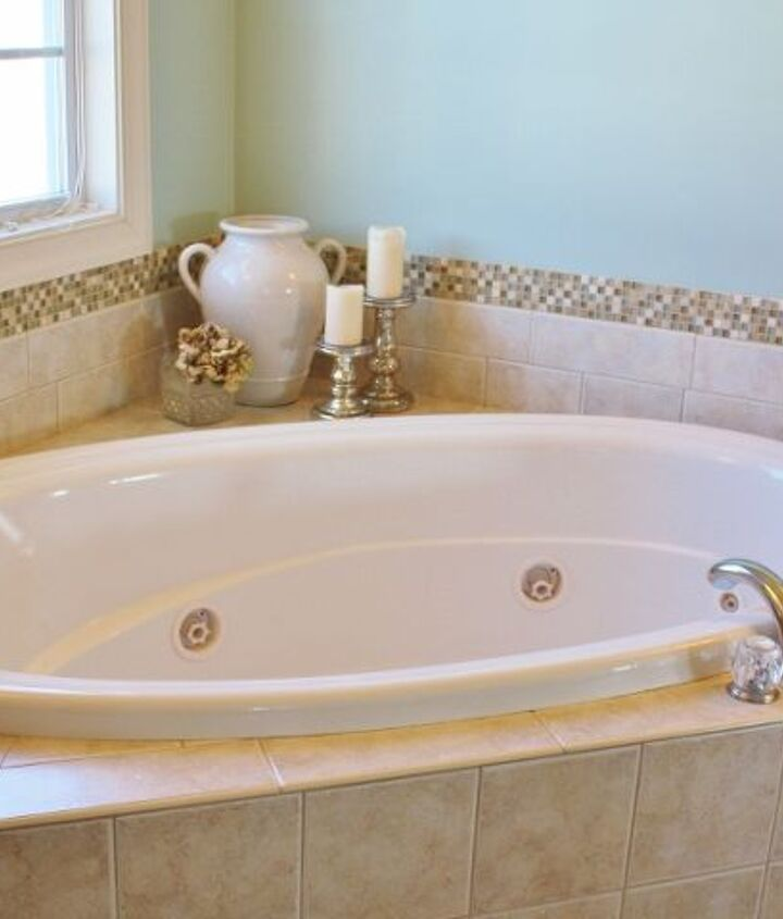 How to add a decorative stone and glass mosaic tile border around a bathtub.