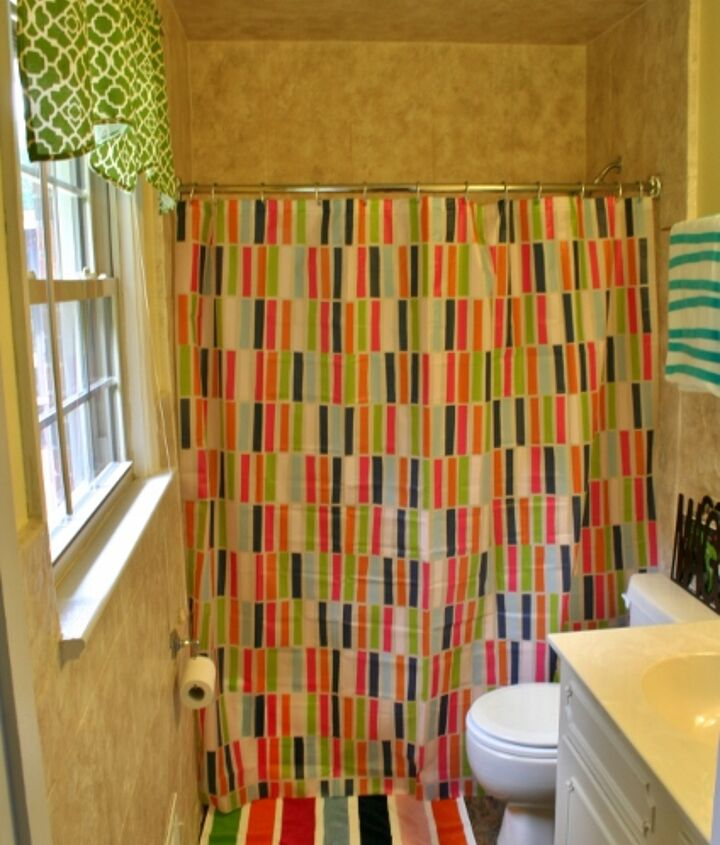 Lots of color. To keep the curtain (which was already in the bathroom from our previous décor) or not to keep the curtain?