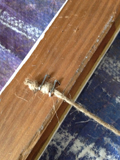 Attach twine, rope or string to the back of the frame.