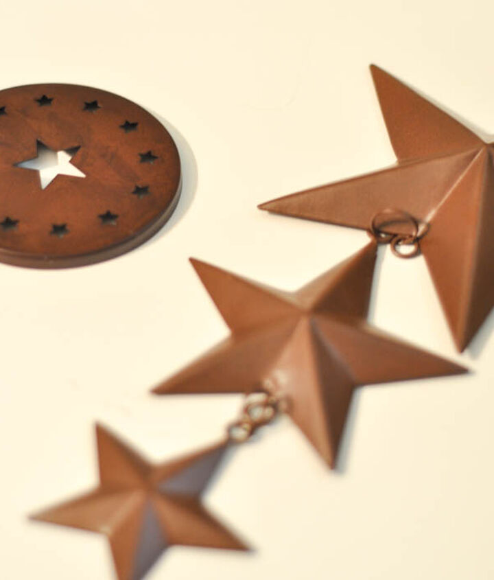 This metal star wall art and decorative mason jar lid were bought for a song.