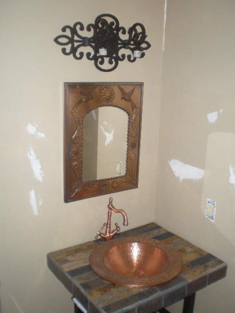 I picked up a copper mirror in old town Colorado City, Co at a Mexican import store, the sink and faucet came from ebay. The sink had a small dent in it, which I turned toward the faucet, $75 bucks! I was thrilled!