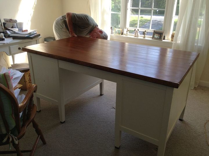 Hubby setting up my work space.  I used  2 coats Ben Moore White Linen after priming..lots of cleaning before hand. Golden oak stain and 3 coats of poly!  Love Love
