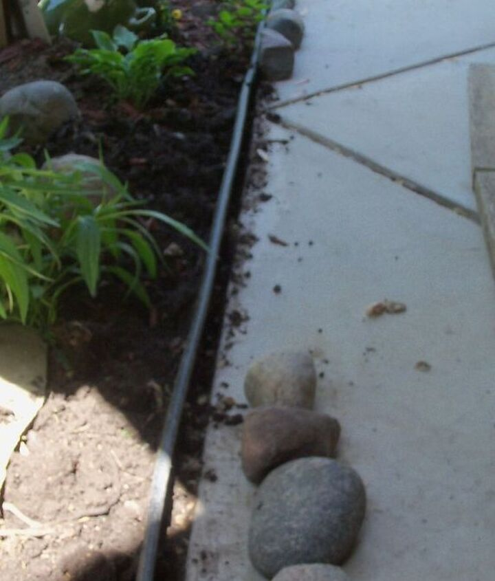 finishing touch with edging stones, concrete masonry, flowers, gardening, landscape