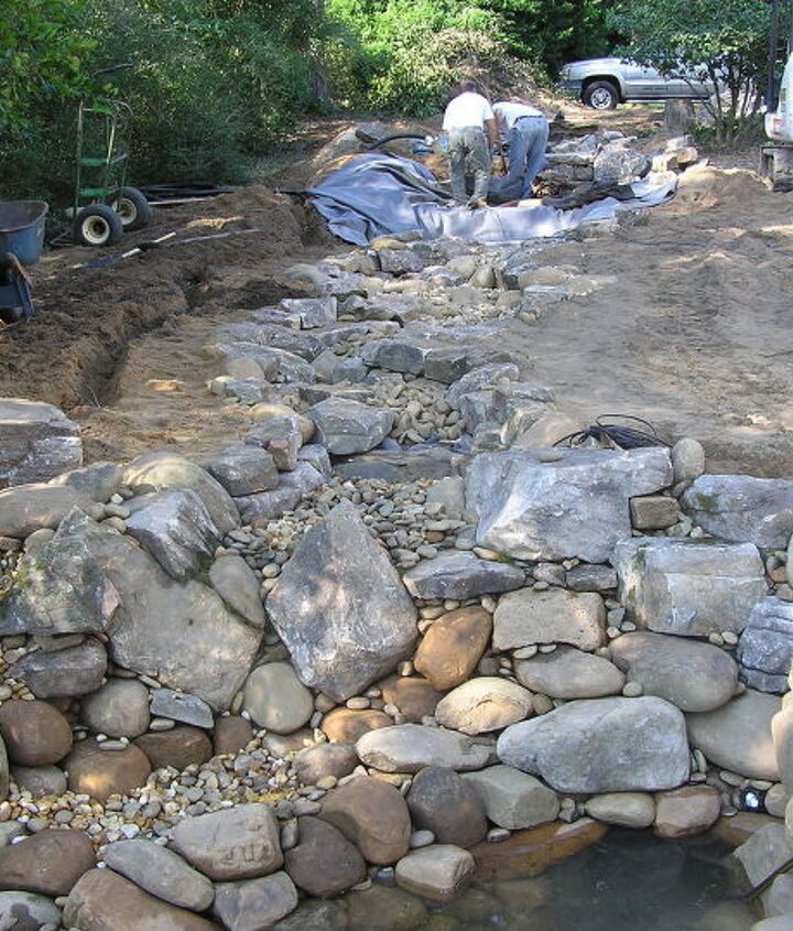 """Next in the process is creating the stream formation. This is where creativity meets form and function. Stream construction is often a signature among Pond builders, allowing creativity through """"rock placement"""". Let it rip!"""