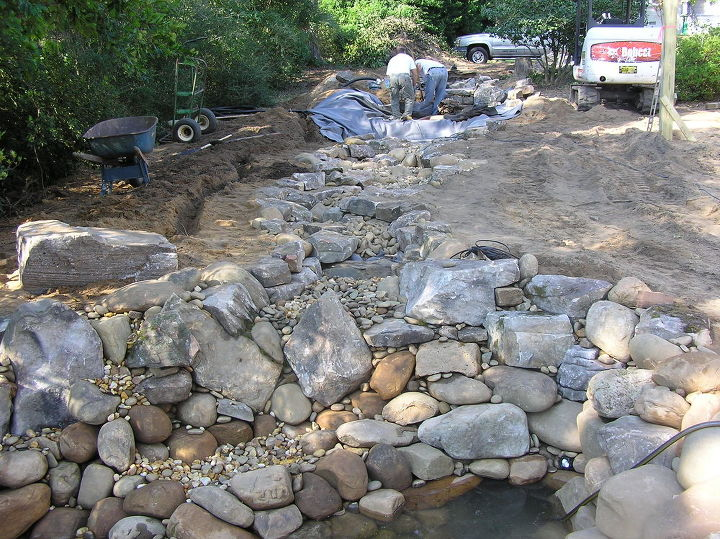 "Next in the process is creating the stream formation. This is where creativity meets form and function. Stream construction is often a signature among Pond builders, allowing creativity through ""rock placement"". Let it rip!"