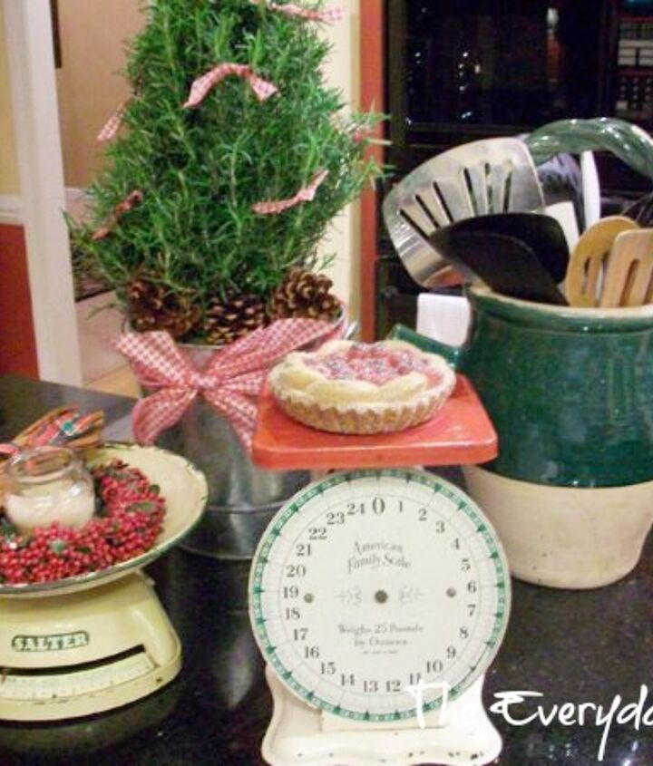 Vintage kitchen scales and a pretty rosemary topiary.
