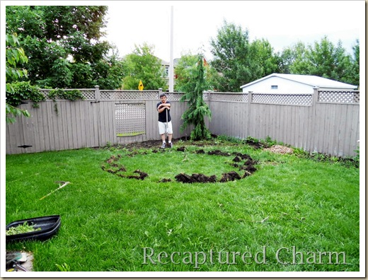Cut a circle the size you want your patio and remove all grass and dirt to about 6 inches down minimum   http://www.recapturedcharm.com/2010/06/fire-pit-patio.ht