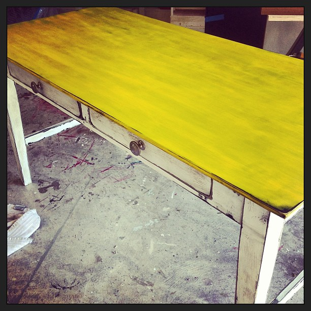 BRIGHT yellow muted a bit by dark wax with a shabby white lower half...