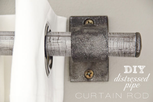 Distressed metal curtain rod gives a unique look!