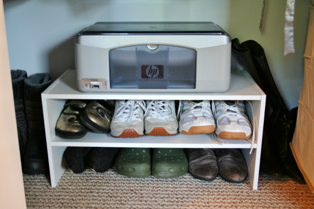 Double a shoe stands power by using it as shoe storage and as a printer stand