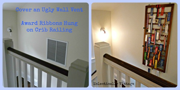 The before - huge wall vent.  The after - ribbon display that doesn't block the vent but hides it.  http://eclecticallyvintage.com/2012/08/and-the-ribbon-goes-to-creatively-disguising-an-ugly-wall-vent/