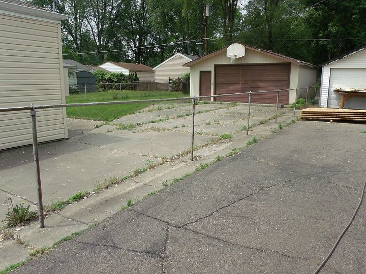 South side. Cyclone fence removed, before new fence up. That's the neighbor's driveway and garage, not ours btw.
