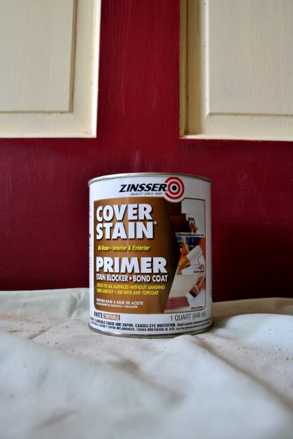Find out if the prior paint is oil or latex. Prime the door with the appropriate primer.