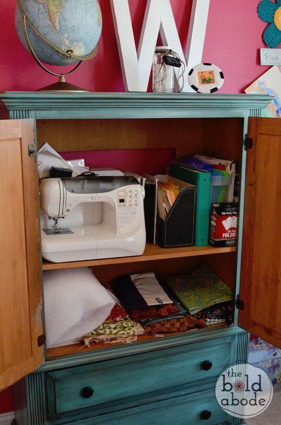 Using an old TV armoire provides extra storage for Sewing supplies.