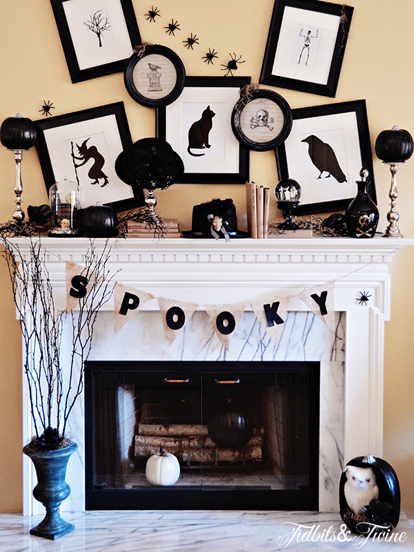 A black, white and silver Halloween mantel.