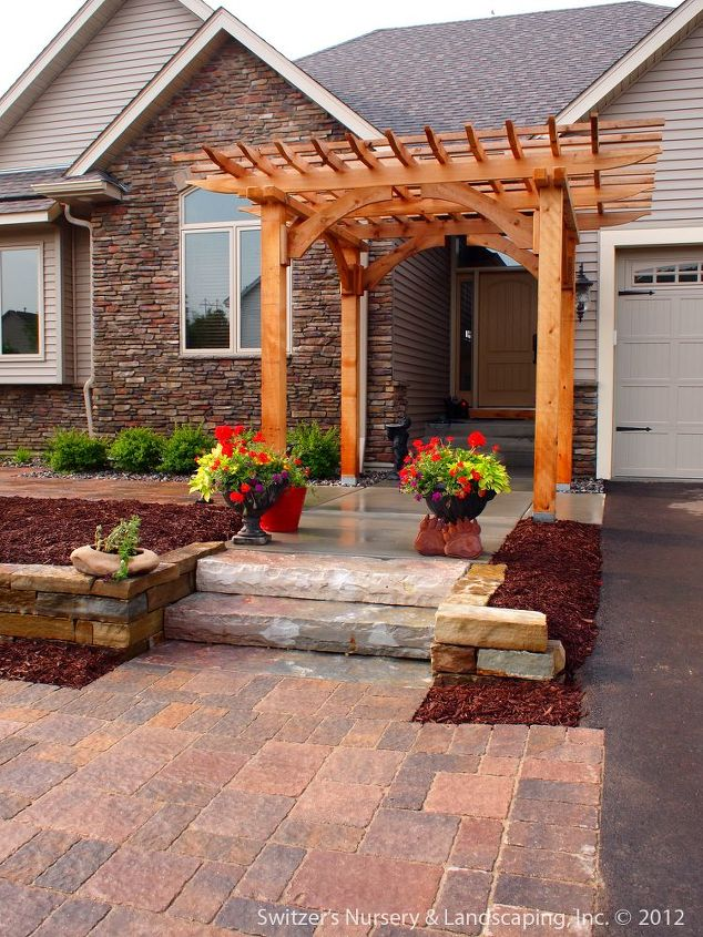 Natural stone steps and retaining wall add to the main axis of the entrance.