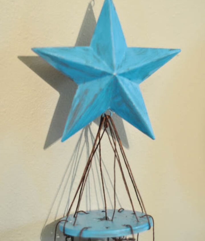 Using waxed thread, I tied the pipes and the decorative star to the mason jar lid. The two smallest starts are used as the paddle in between the pipes.