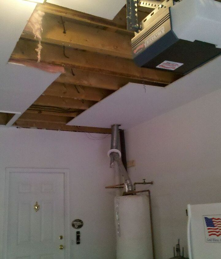 New water lines had to be installed, along with two new water heaters; therefore, the garage ceiling had to be cut.
