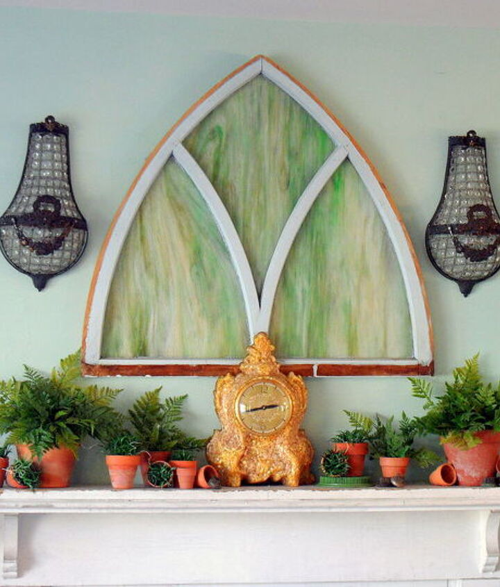 Antique stained glass stands in as art over the mantel.