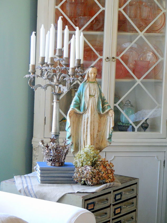 Candelabrum add grandeur to any space and balance the large Madonna statue.