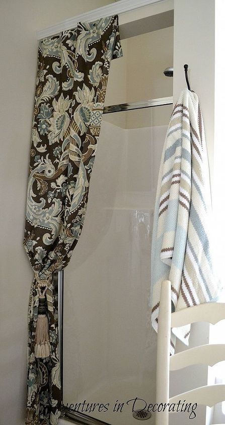 The shower curtain, which is tacked to the wall, is more decorative than functional.