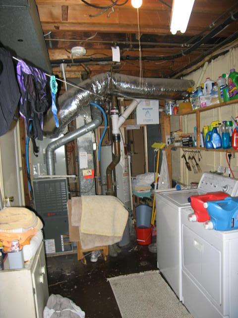 Schroeder Design/Build before picture of laundry room www.SchroederDesignBuild.com