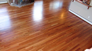 q we have hardwood floors before we moved in 10 yrs ago we had them refinished, flooring, hardwood floors, This tiger wood area was just screened and re coated the kitchen in the back was a full sand stain job