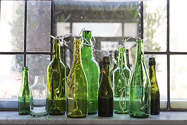 green bottles window sill, fireplaces mantels, home decor, seasonal holiday decor