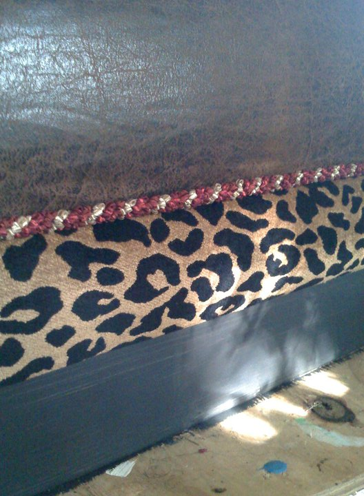 I upholstered using a variety of fabrics and a shimmery red and gold trim to add a little spice.