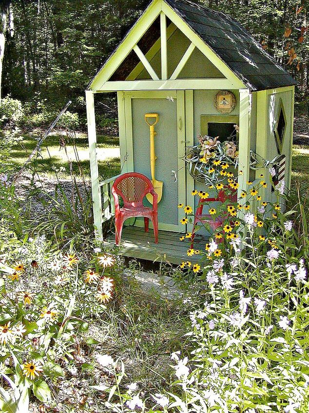 A playhouse for my grand daughters sit in the meadow boarder.