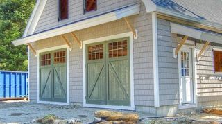 q what is the term for the decorative overhanges over some garage doors, doors, garage doors, garages