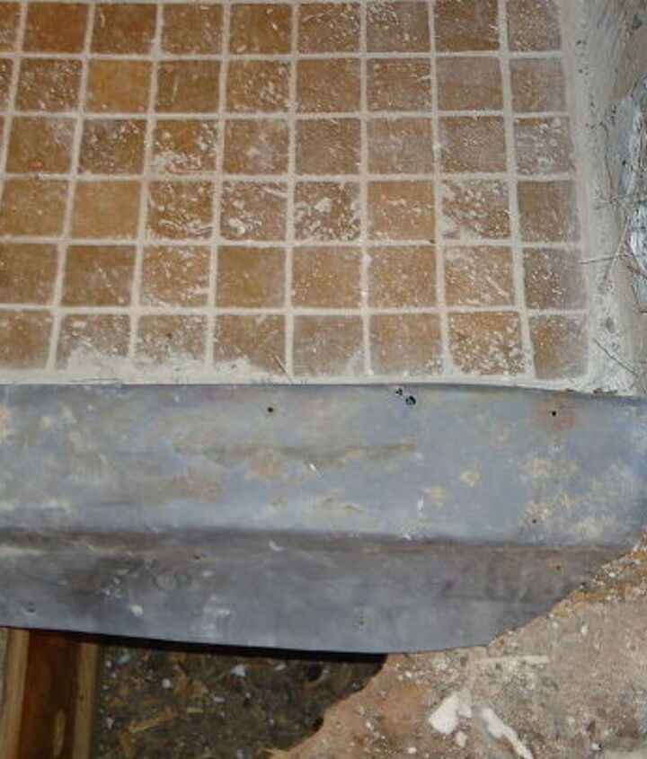 Well - after we got the curb up, we had nails through the top of the curb and the membrane was cut in the corners