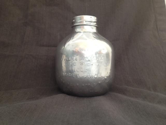 silvered Martinelli's glass apple juice bottle