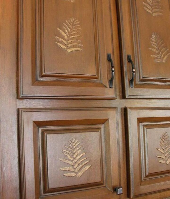 I painted & glazed these cabinets with a caramel color paint, then glazed w/black...