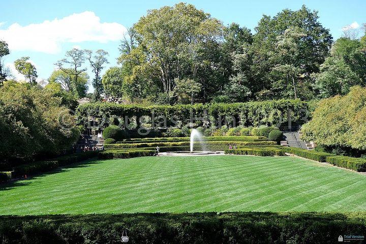 The Italianate central garden with fountain and wisteria-covered pergola.