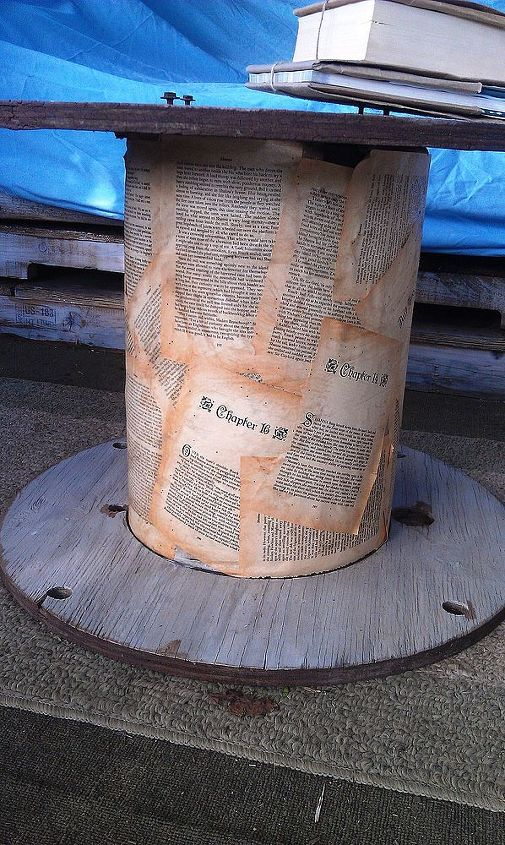 I also decoupaged pages from a book onto the heavy cardboard spine of this table to make it more attractive.  I sprayed tea on the pages to give it more of a vintage look.